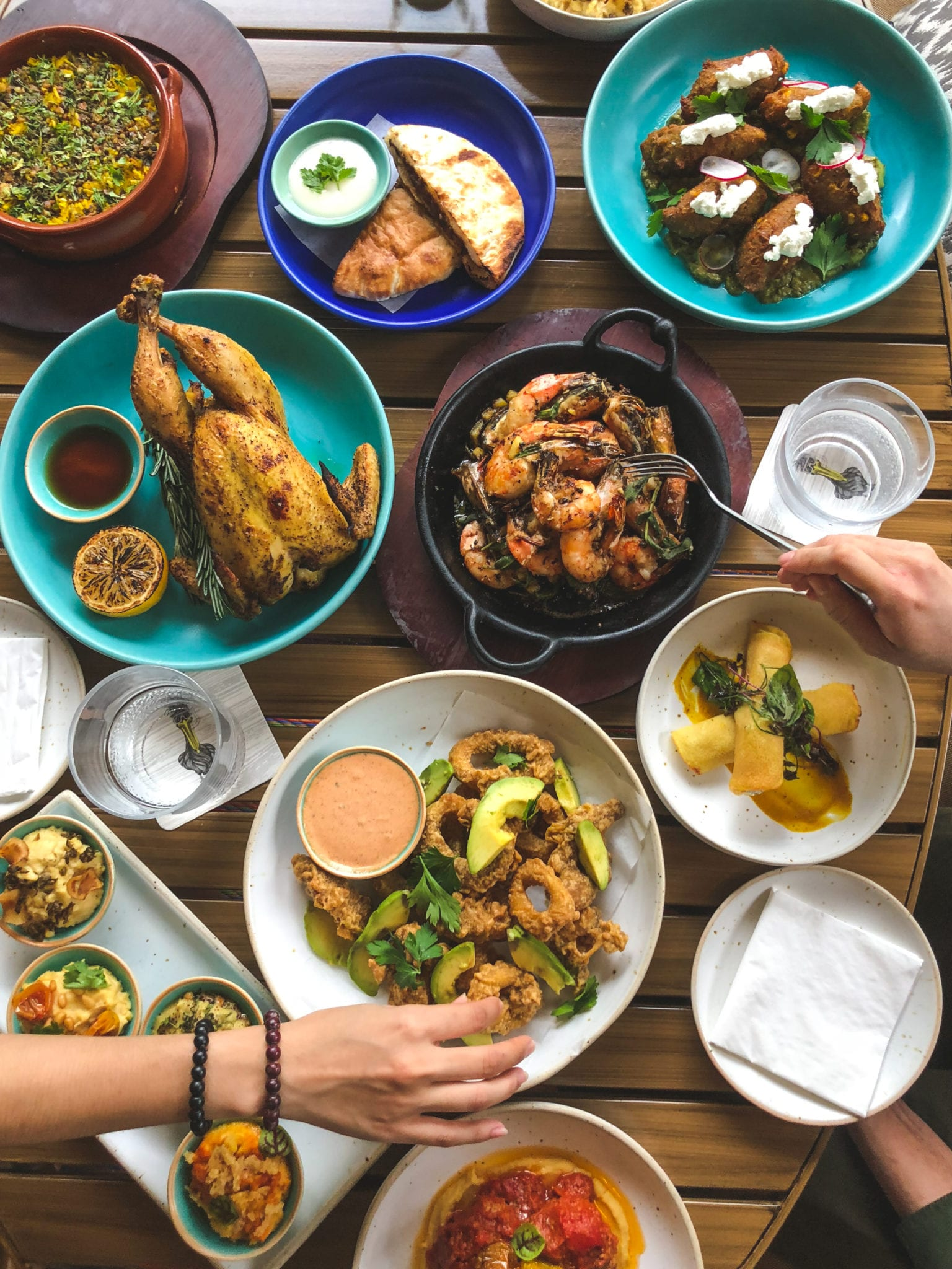 flatlay of western Mediterranean dishes on a table