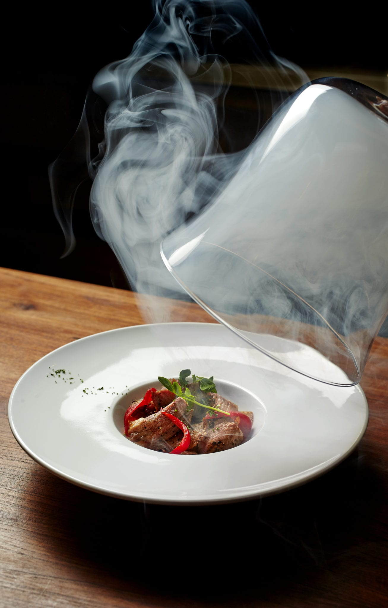 dry ice over plate of pasta