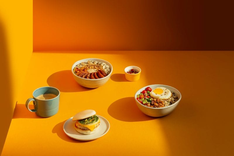 assorted salad bowls, sandwich and 2 cups of drinks