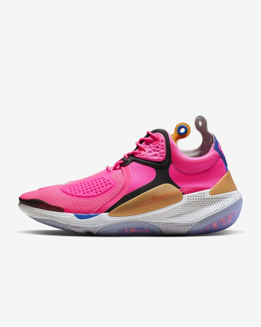 hot pink shoes with black and yellow detailing