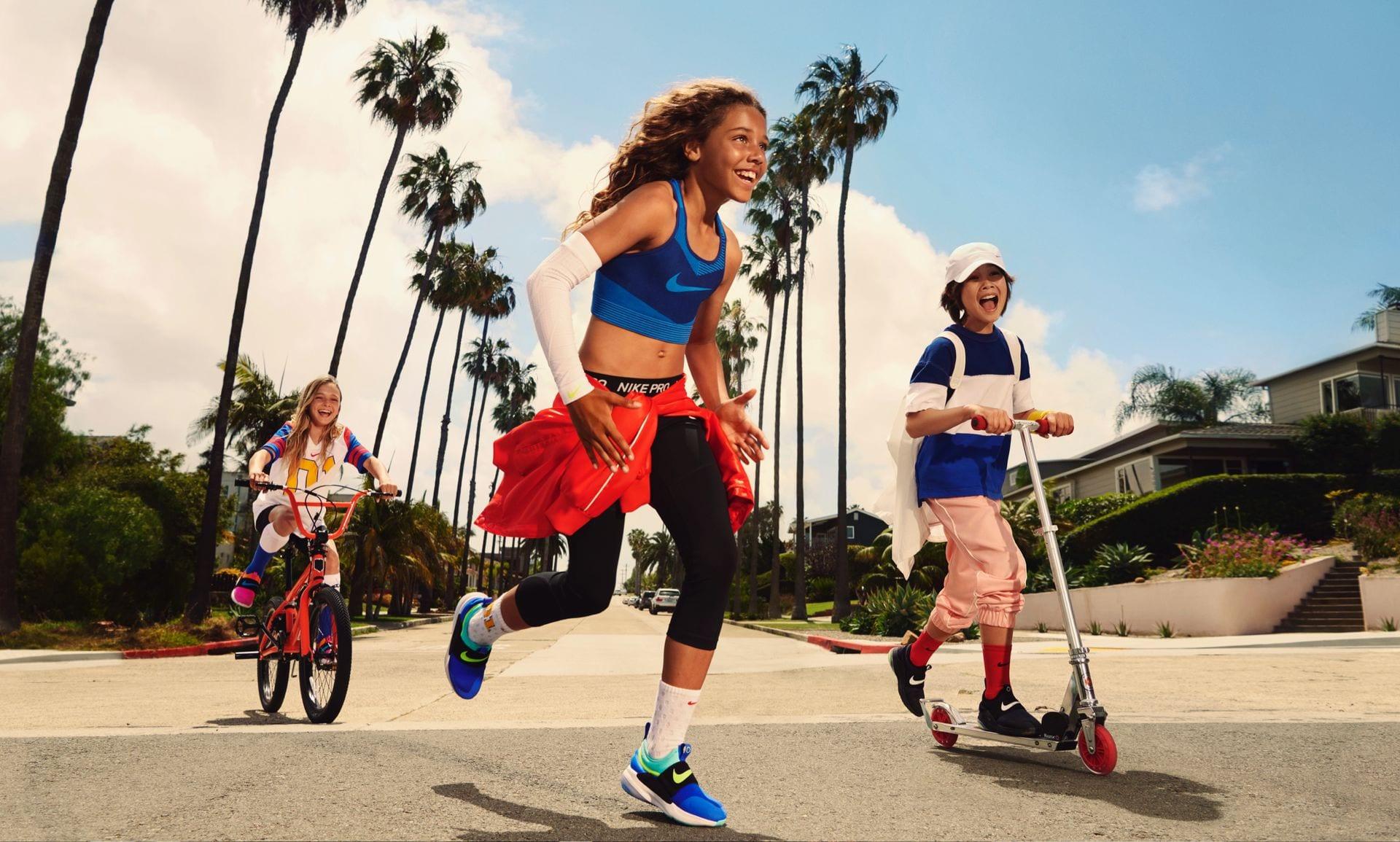 three kids running around in nike shoes
