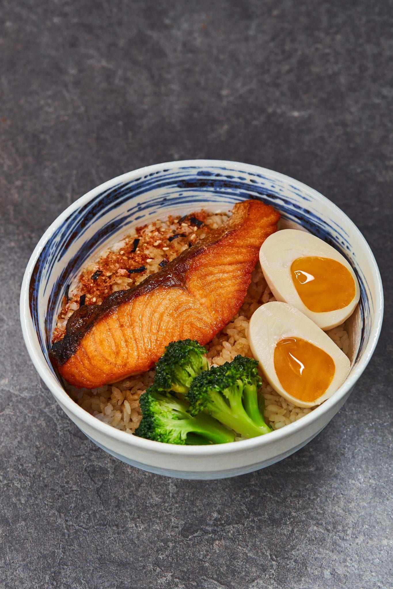grilled salmon with half boiled egg rice bowl