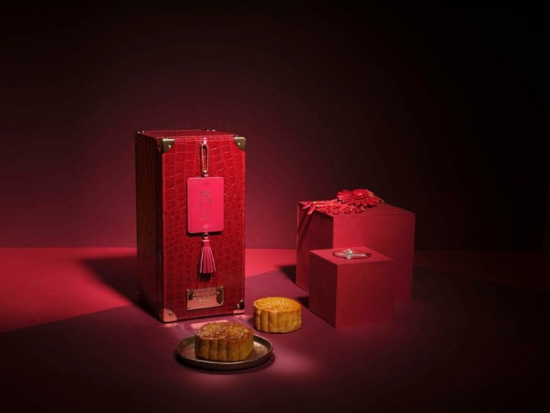 traditional box of mooncakes in red ornaments and casing