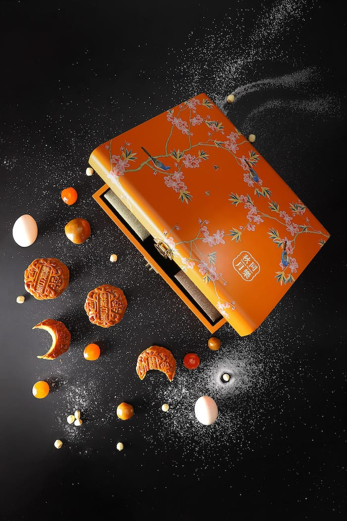 orange box of mooncakes with gold clasp closure