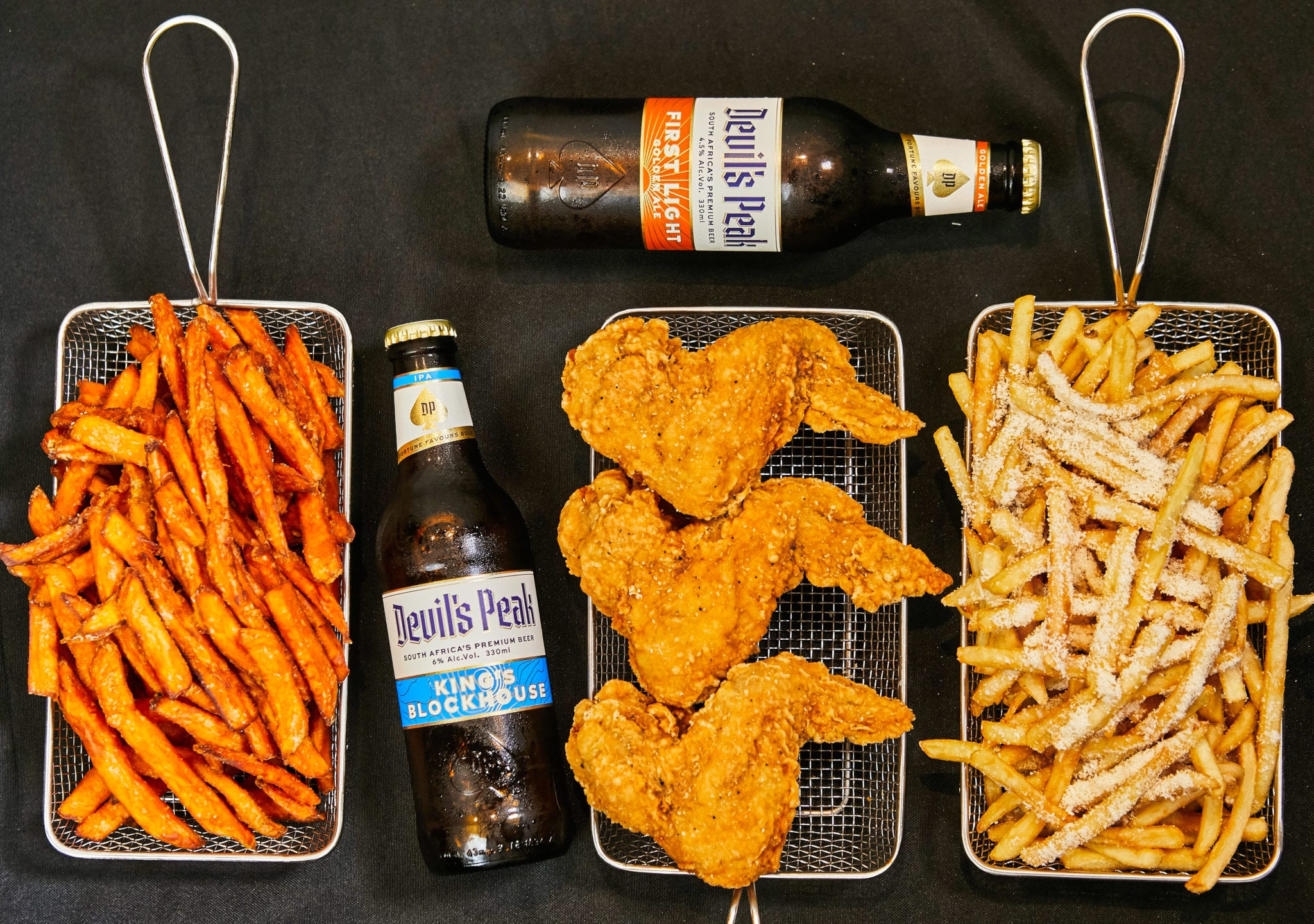 fried chicken wings and fries with beer