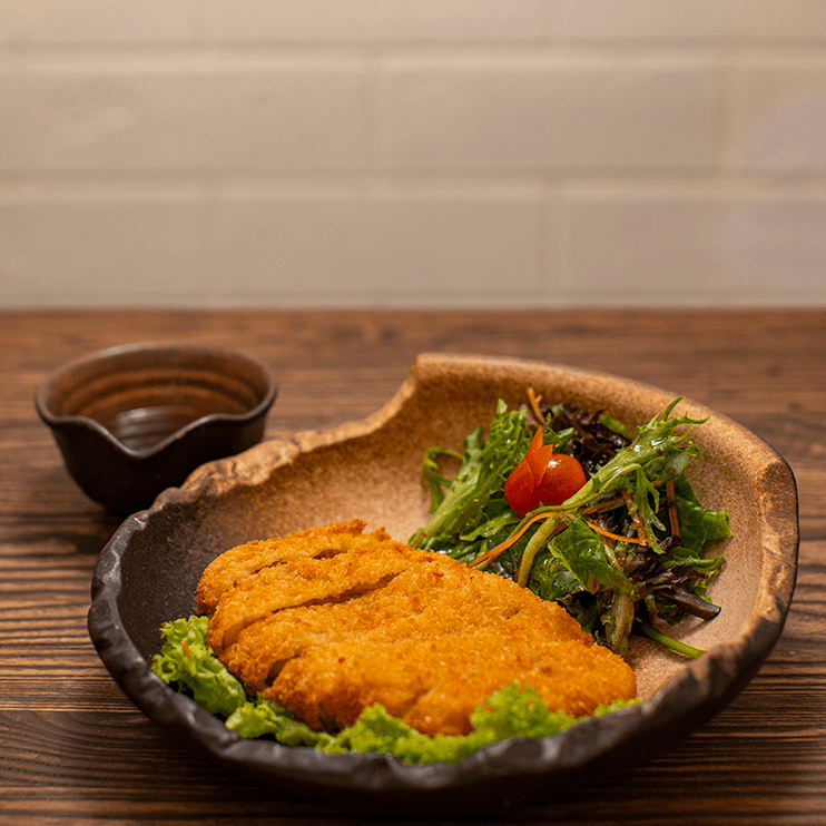 fried pork cutlet with salad and sauce dip