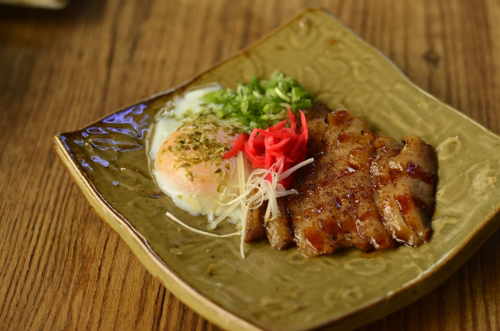 grilled pork jowl with egg and garnish