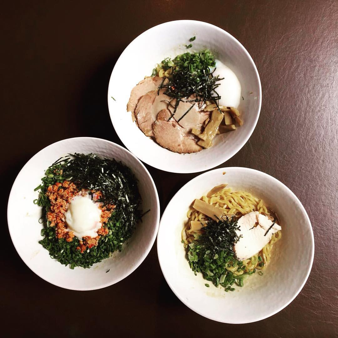 three bowls of dry ramen with onset egg