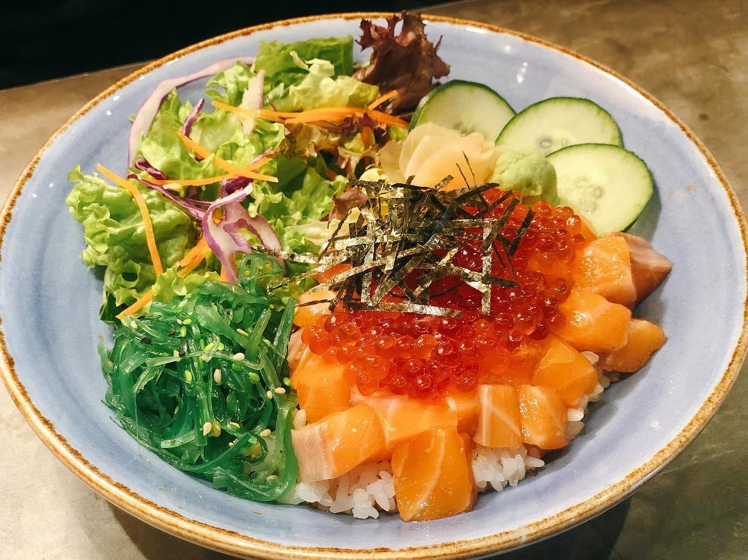 fresh sashimi and salmon roe with salad rice bowl