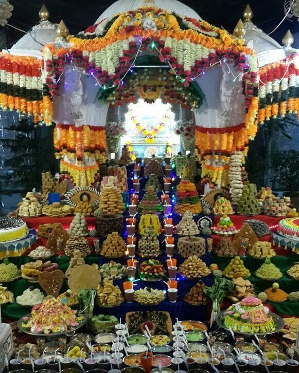 stacks of vegetarian food offered to Indian God