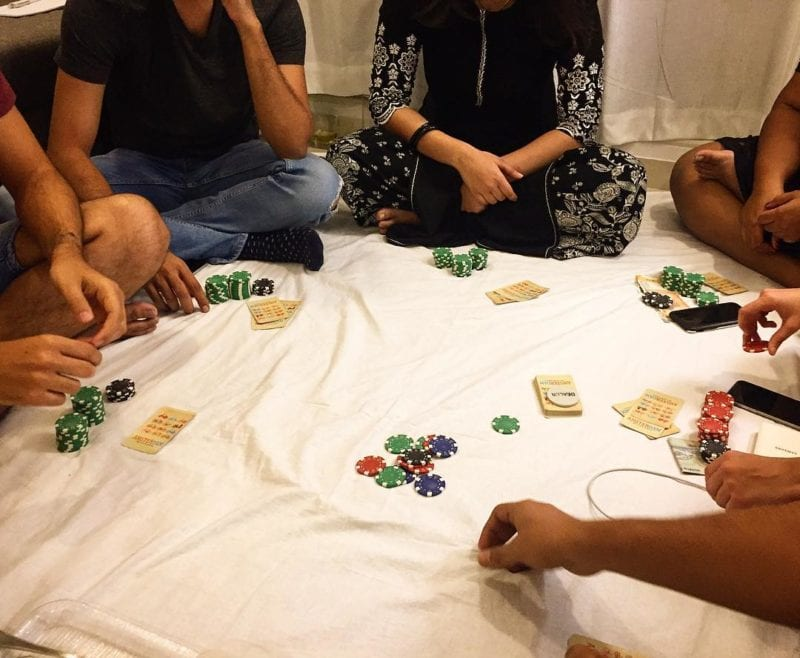 group of friends playing with chips