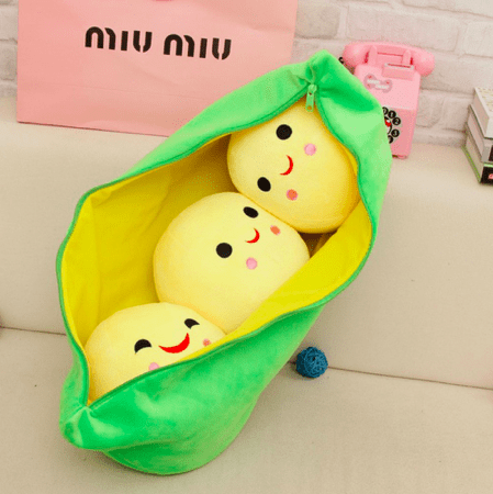 three yellow beans in a pod