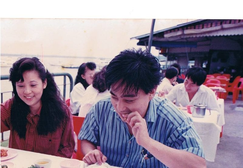 film photo of man and woman eating seafood