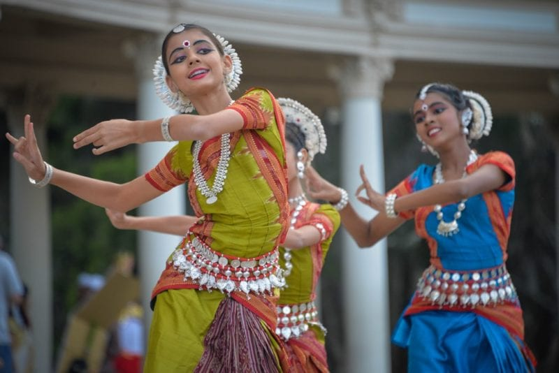 three woman performing a traditional dance