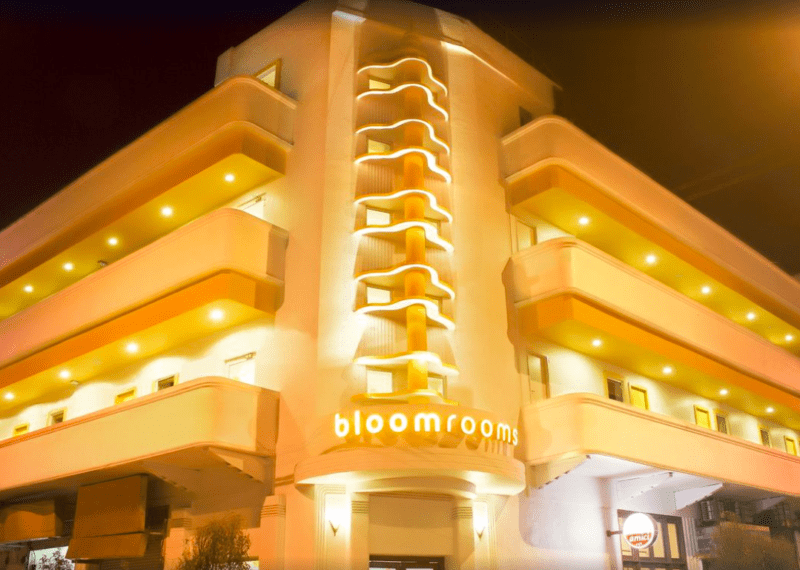 hotel lit with warm yellow lights at night
