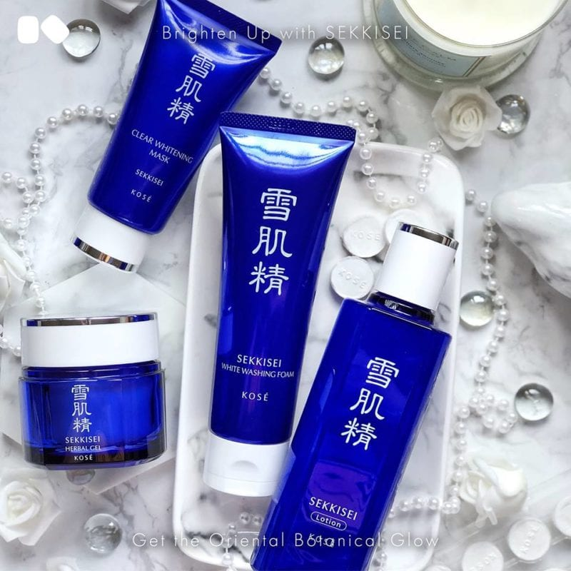 three blue bottles of Japanese skincare