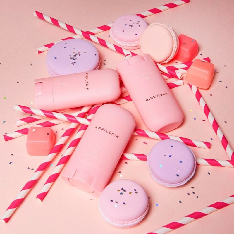 sunscreen sticks decorated with candy canes and macarons
