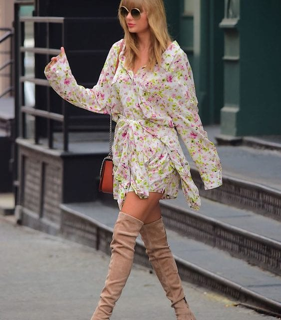 taylor swift in a floral romper and suede boots