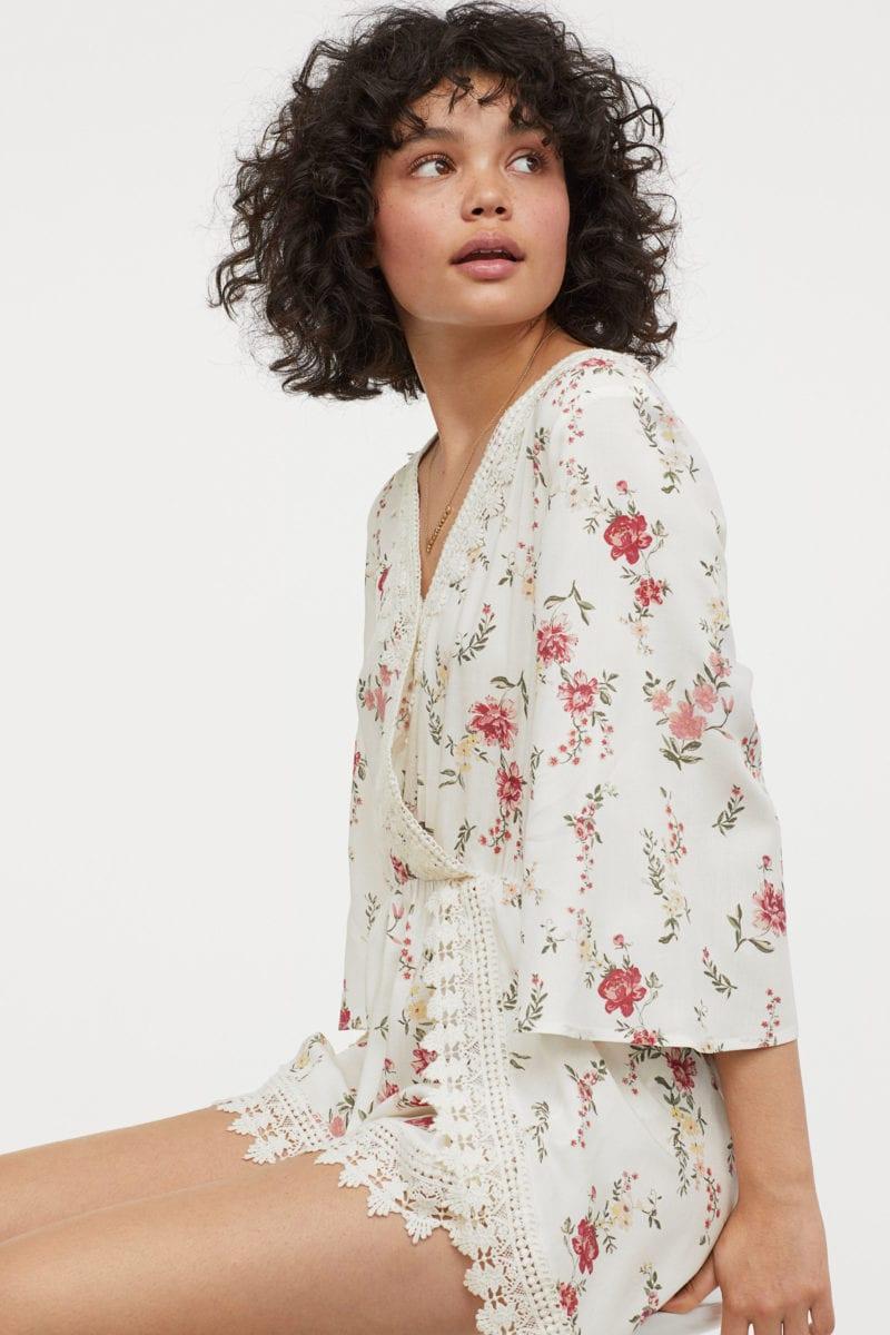 model wearing floral lace romper