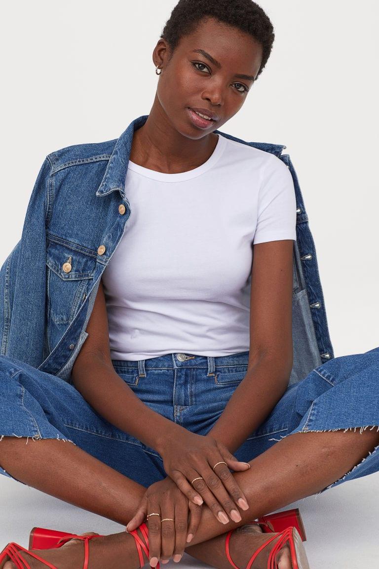 model wearing white tee with denim jacket