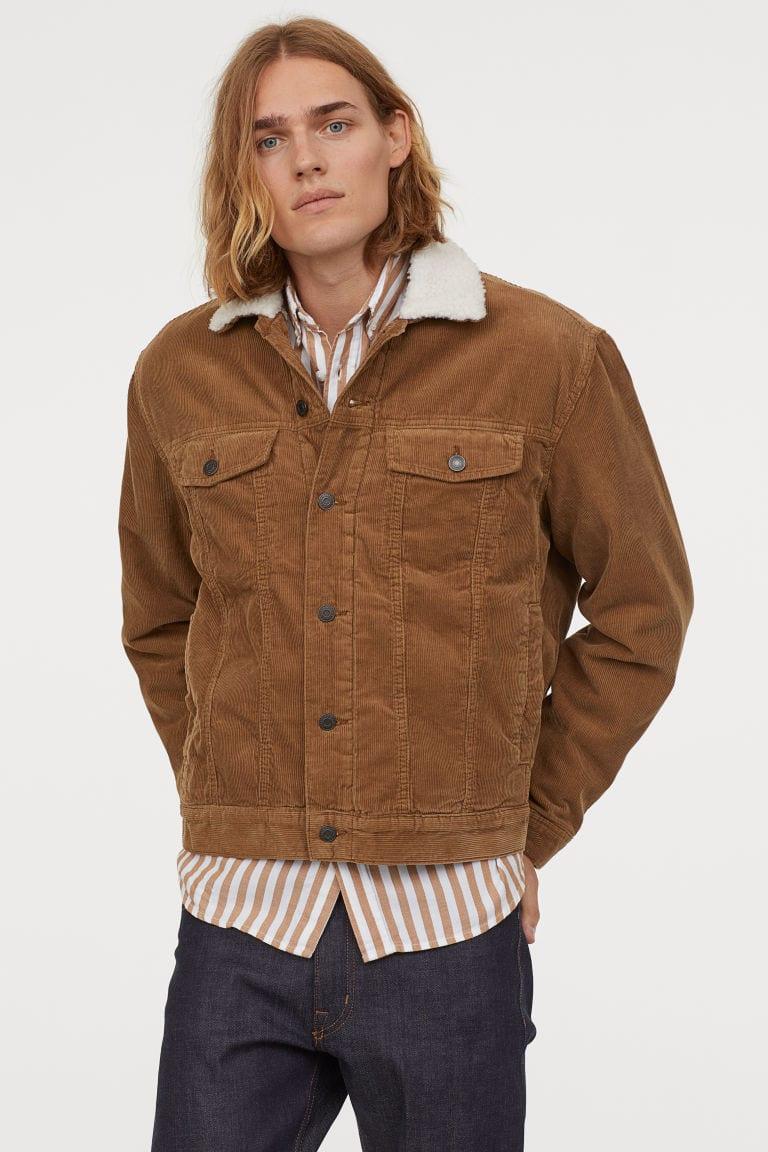male model wearing a lined corduroy beige jacket
