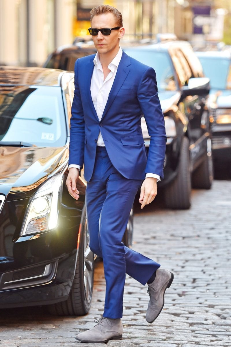Tom Hiddleston in blue suit and sunglasses