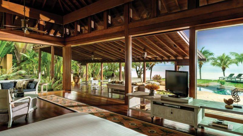 rustic wooden teak villa overlooking beach with plasma tv