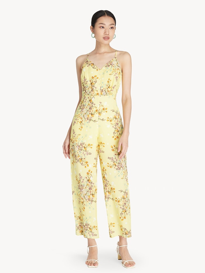 Asian model wearing yellow floral sleeveless jumpsuit