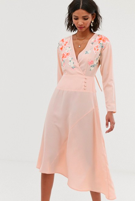 tanned model in blush pink embroidered long sleeves dress