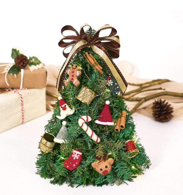 artificial christmas tree from far east flora with assorted christmas ornaments